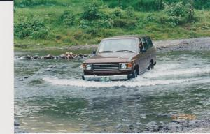 Driving across a river in Todd's Landcruiser